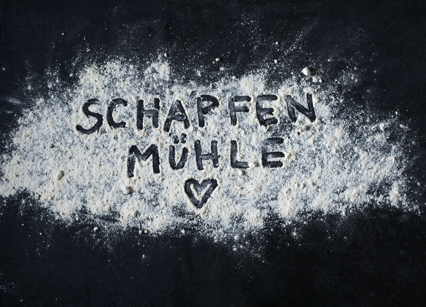 Picture SchapfenMühle written in flour